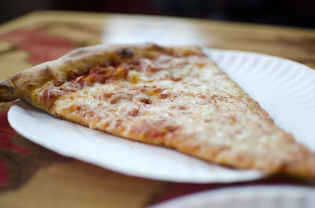 a slice of cheese pizza from Gracie's Pizza
