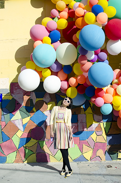 hanhgry.com | rainbow dress and sunglasses in front of balloon wall