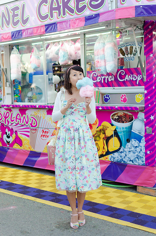 hanhgry.com | eating cotton candy in unique vintage chateau swing dress in mint llama fun fair print