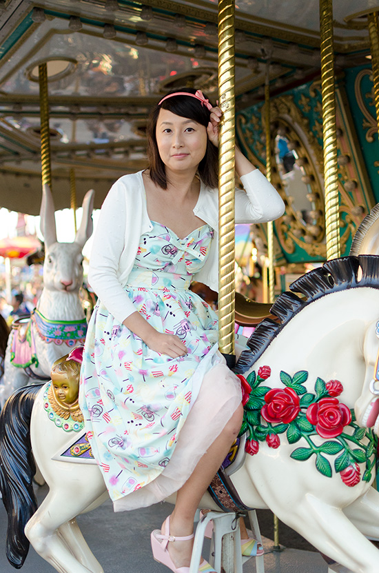 hanhgry.com | riding merry go round in unique vintage chateau swing dress in mint llama fun fair print