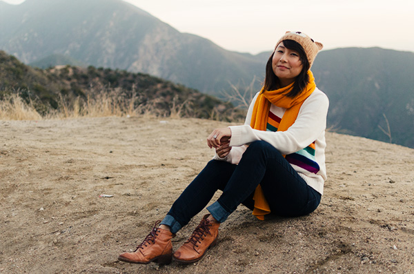 hanhgry.com | rainbow sweater and mustard scarf sitting on ground in the angeles national forest