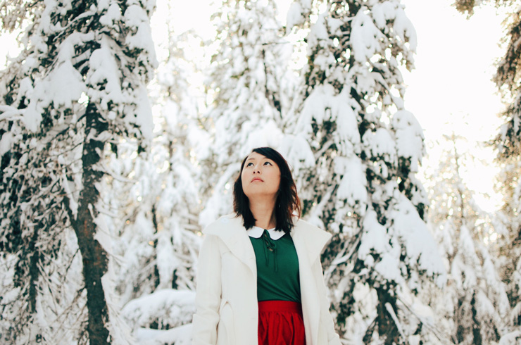 hanhgry.com | red gingerbread skirt standing in snow looking up at sky