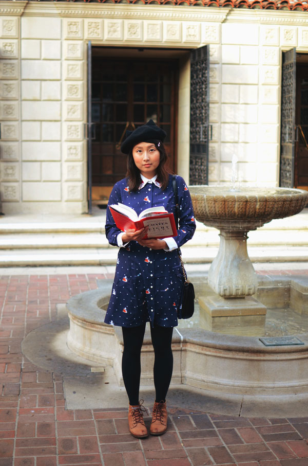 hanhgry.com | standing in front of library fountain holding a book, in Miss Patina Kiterature dress