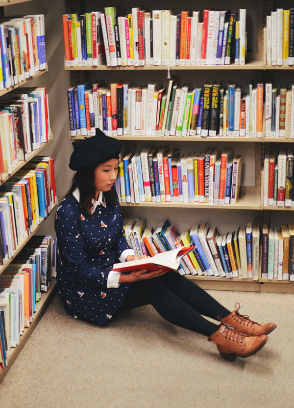 hanhgry.com | wearing Miss Patina Kiterature dress, sitting on the floor in the corner of the library
