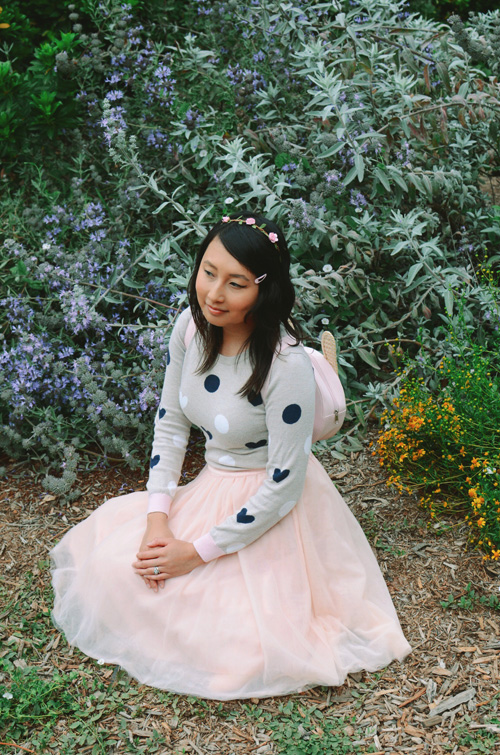 outfit: hanh in a gray polka dot GapKids sweater with a pink tulle skirt, sitting down on the ground with her skirt circled around her